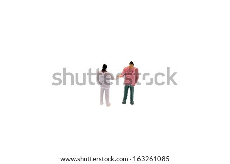 Business figurine miniature on a white background - stock photo