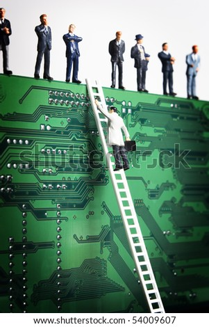 Business figurines and a small ladder placed against a circuit board
