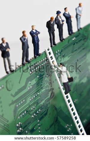 Business figurines and a small ladder placed against a circuit board - stock photo