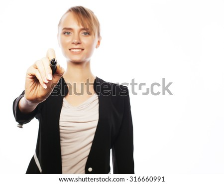 Business, finance and people concept: young business woman writing something in the air with marker - stock photo