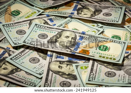 Business finance concept background of hundred dollars bank notes bills of new 2013 year edition - stock photo