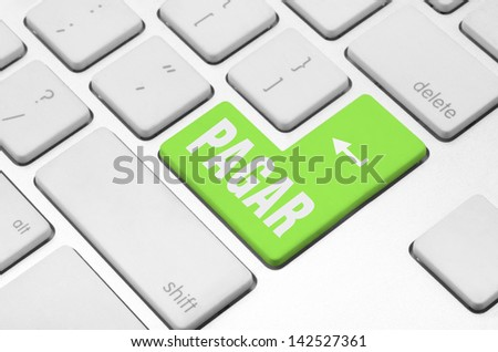 "Business finance concept: key ""Pay"" in Spanish language on the computer keyboard"