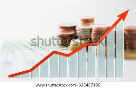 business, finance, investment, saving and cash concept - close up of euro paper money and coins on table - stock photo