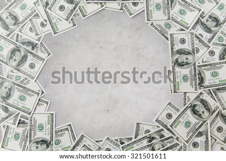 business, finance, investment, saving and corruption concept - close up of dollar money over concrete background - stock photo