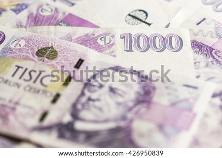 business, finance, saving and cash concept - close up of czech paper money and coins on table - stock photo