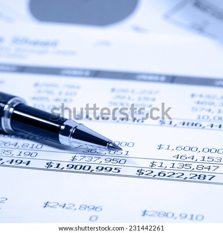 Business financial report with black pen, blue tone