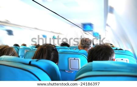 Business flight - airplane cabin - speed effect - stock photo