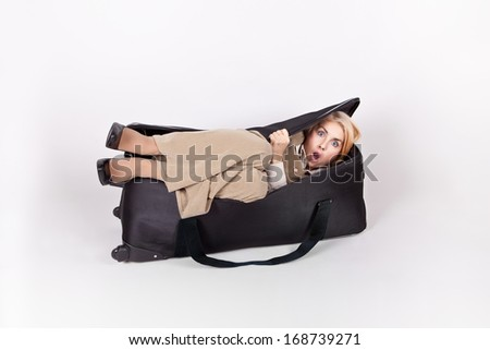 Business frightened girl hiding in a big bag