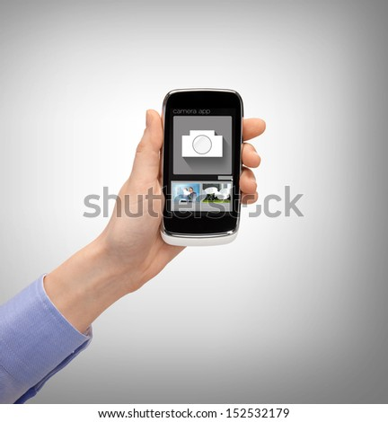 business, future technology and internet - hand with smartphone showing instant picture application