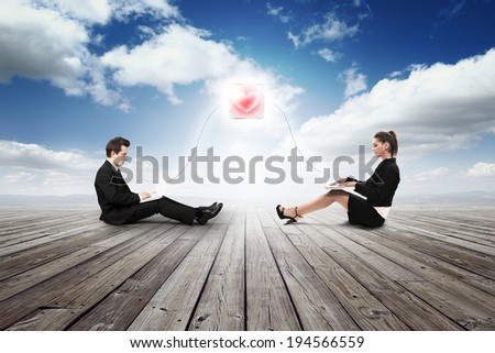 business girl and man are falling in love with laptop - stock photo