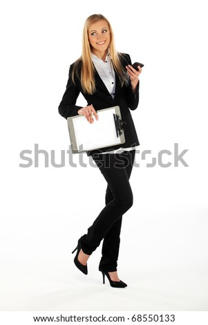 Business girl called in the middle of walking while tex-ting message on mobile phone - stock photo