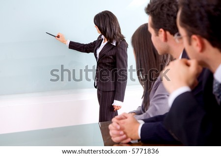 business girl doing a presentation in an office meeting - stock photo
