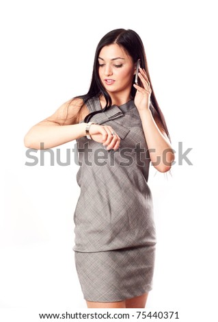 Business girl looking on her watches - stock photo