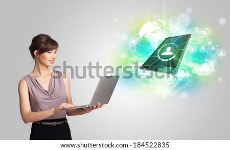 Business girl showing modern green tablet technology concept - stock photo