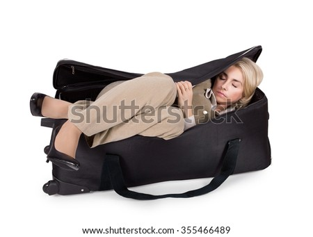 Business girl sleeps in a big bag