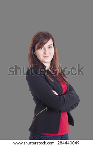 Business girl smiling and cross arms - stock photo
