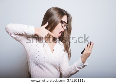 business girl with glasses angry on the phone, isolated on background - stock photo