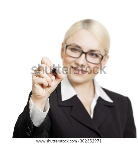 Business girl with glasses writes a marker