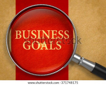 Business Goals through Magnifying Glass on Old Paper with Crimson Vertical Line Background. 3d Render. - stock photo