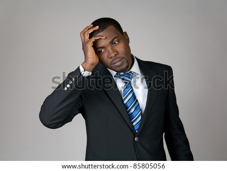 Business going wrong. African American businessman looking frustrated.