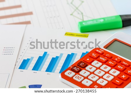 Business graph analysis with calculator - stock photo