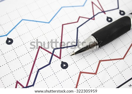 Business graph and pen on it.  - stock photo
