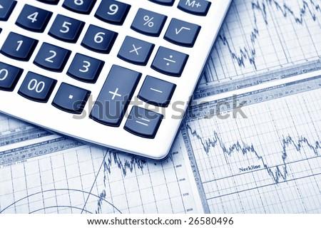 business graph & calculator. Blue tone - stock photo