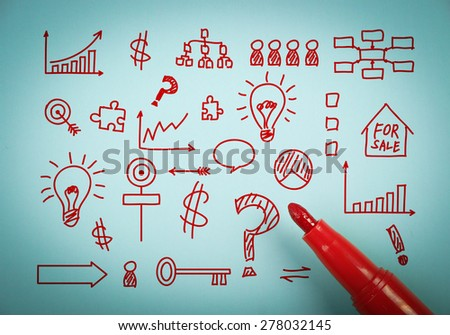 Business graph is on blue paper with a red marker aside. - stock photo