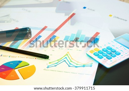 Business graph of financial analytics and pen.Business Concept