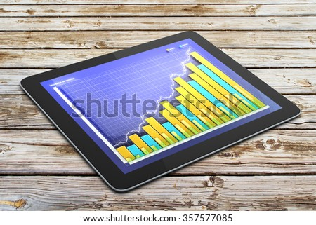 Business graph on digital tablet screen on wooden table - stock photo