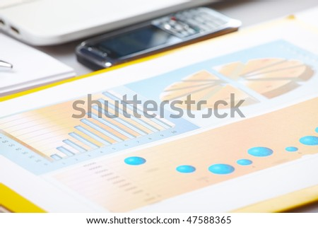Business graph on financial sells or popularity report. Diagrams are printed and helpful in showing analyzes data in graphical form in business conferences, board meetings and presentations. - stock photo