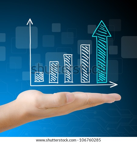 Business graph on hand - stock photo
