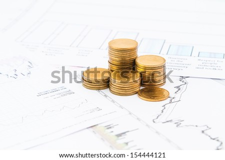 Business graph on paper report with coins