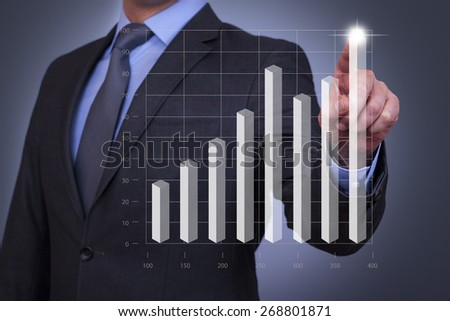 business graph on touch screen - stock photo