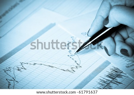 Business graph with hand of woman - stock photo