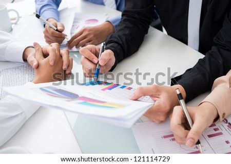 Business group analyzing financial reports - stock photo