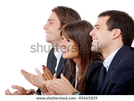 Business group applauding and smiling isolated on white