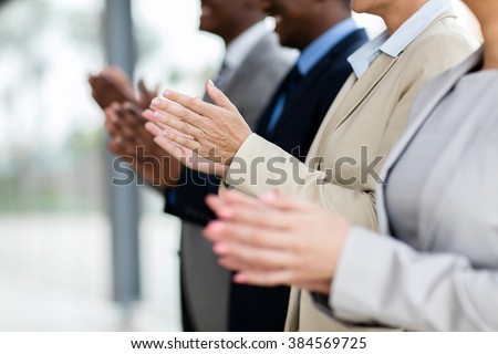 business group applauding during meeting presentation - stock photo