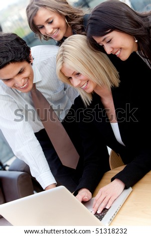 Business group at the office working on a computer - stock photo