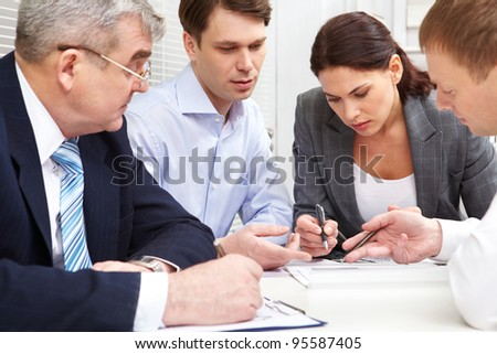 Business group discussing the future perspectives of the strategy - stock photo
