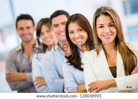 Business group in a row at the office - stock photo