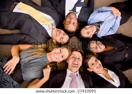Business group in an office with heads together on the floor