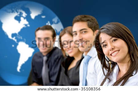Business group in front of a world map - stock photo