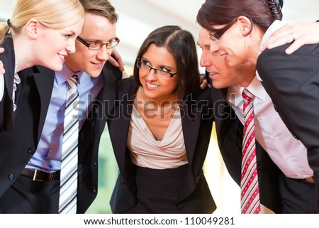 Business - group of businesspeople standing in office, they seem to be a very good team, business metaphor