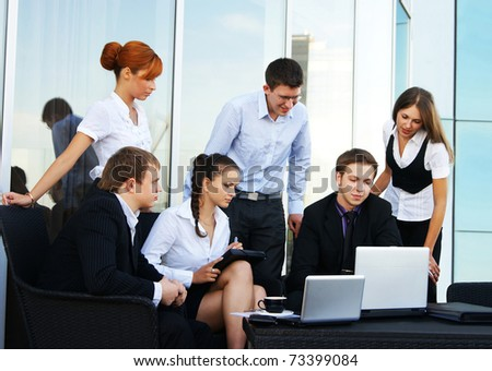 Business group of many different people in office at work