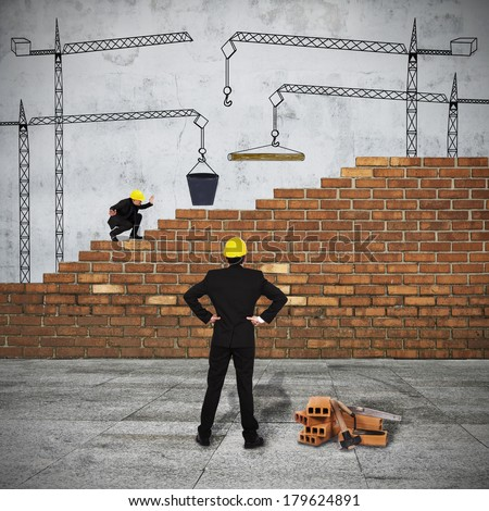 Business group of men building the brick wall - stock photo
