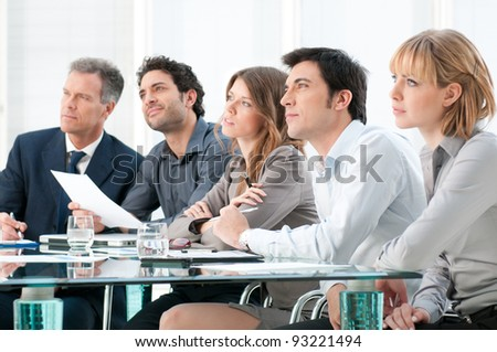 Business group of people attending and listening at conference - stock photo