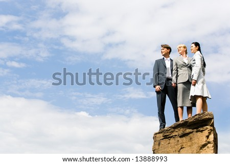 Business group of people standing on the hill and looking aside - stock photo