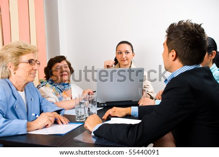 Business group of people young and seniors having a meeting in an office - stock photo