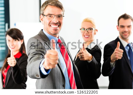 Business - group of successful businesspeople posing in office, Portrait of a businessman - stock photo